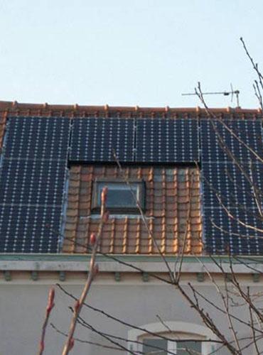 Pose d'un velux et de panneaux photovoltaïques