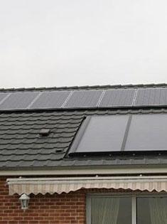Installation de 14 panneaux solaires photovoltaïques Sharp 210