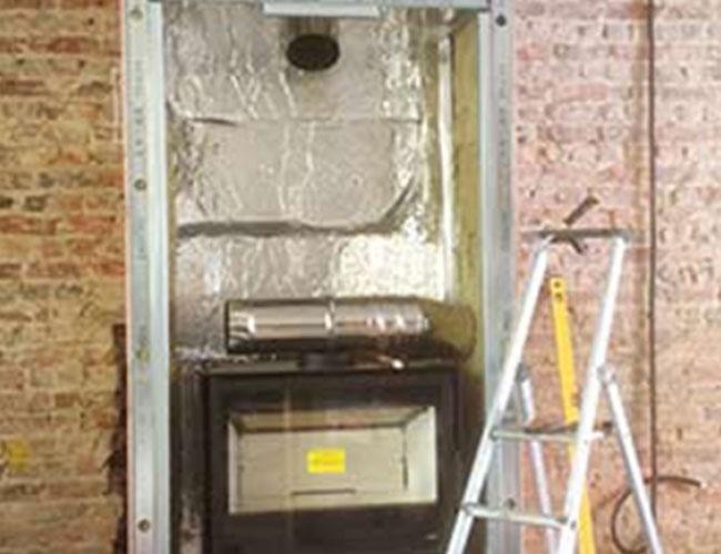 Installation d'un insert à bûches MCZ Boxtherm 80 VN