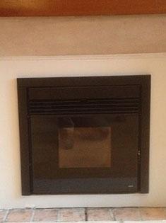 Pose d'un insert MCZ Boxtherm dans une cheminée