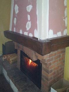 Installation d'un foyer fermé dans une cheminée existante