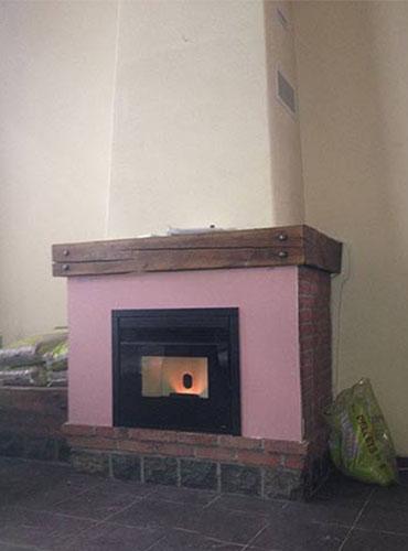 Installation dans une cheminée existante d'un insert bois.