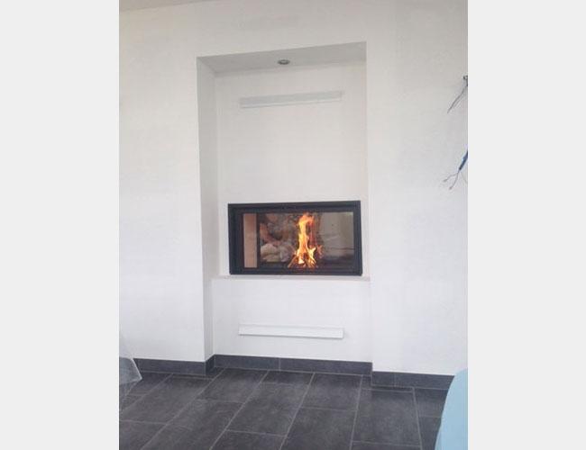Pose d'une cheminée avec un foyer fermé MCZ à Rouen